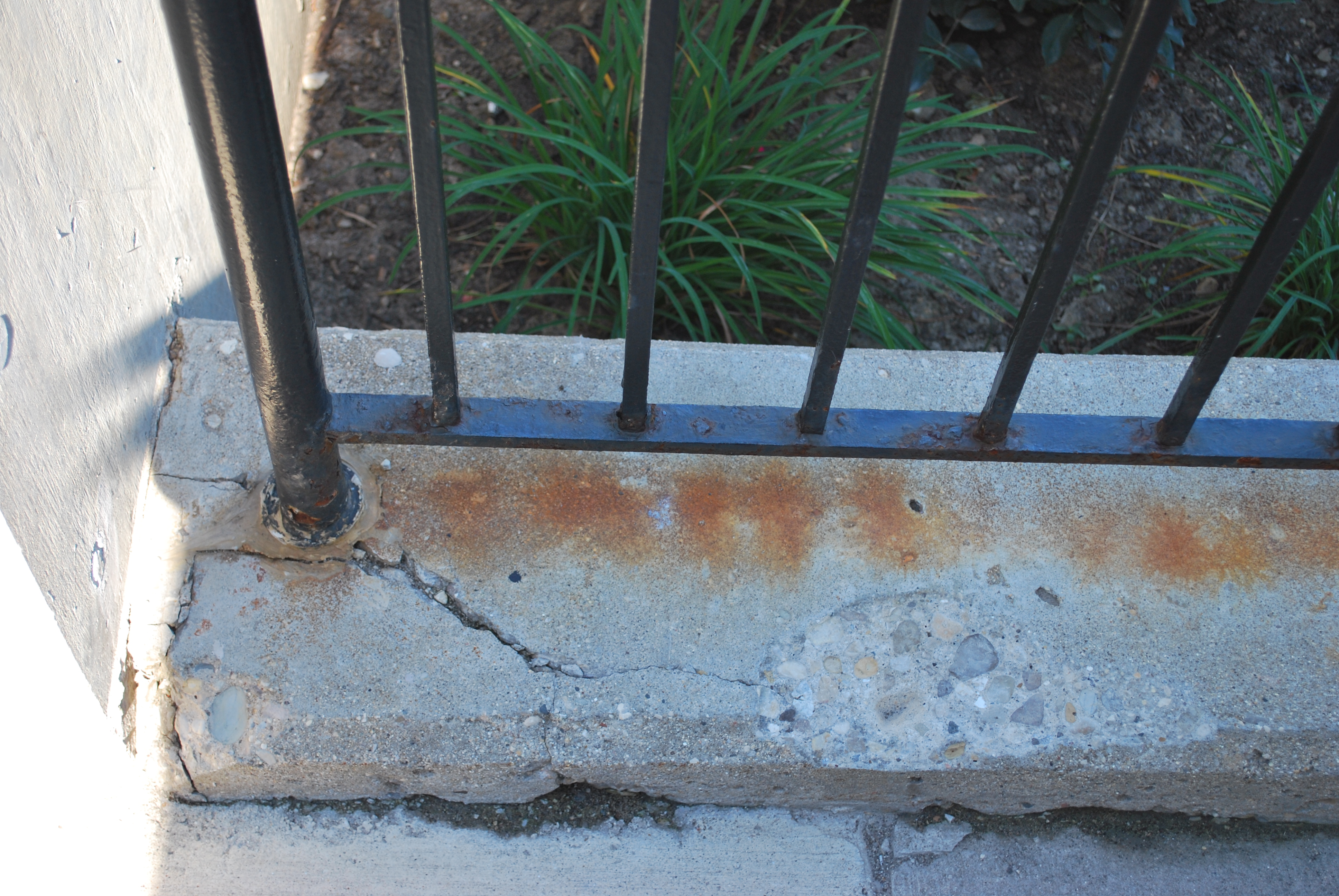 Railings have been compromised in the crumbling concrete retaining walls.